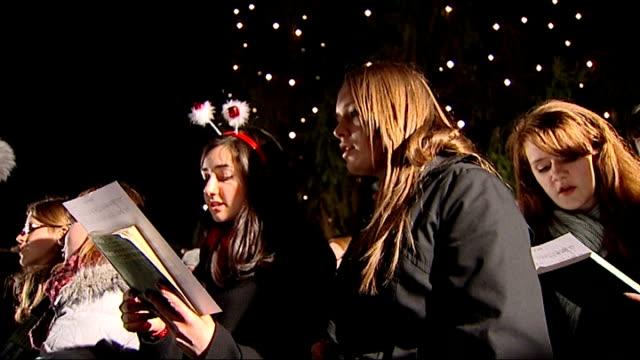 archbishop of canterbury criticises government's plan to encourage people to spend england london trafalgar square various of carol singers singing... - カンタベリー大主教点の映像素材/bロール