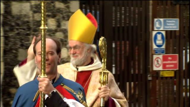 archbishop of canterbury dr rowan williams announces his resignation; lib kent: canterbury: ext dr rowan williams waving as along towards canterbury... - canterbury cathedral stock videos & royalty-free footage