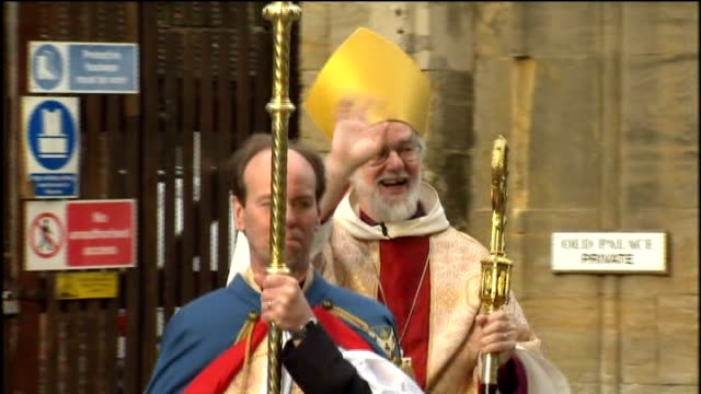 archbishop of canterbury dr rowan williams announces his resignation; lib kent: canterbury: ext dr rowan williams waving as along towards canterbury... - canterbury cathedral stock videos & royalty-free footage