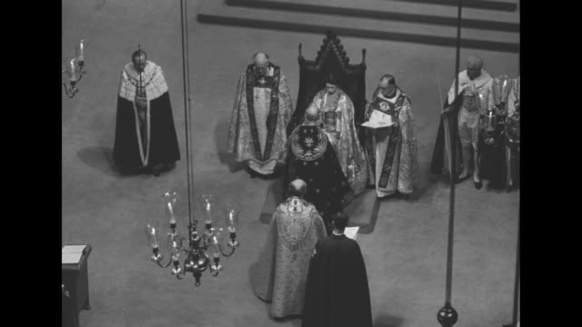 Archbishop of Canterbury Geoffrey Fisher presents the orb to Elizabeth seated in coronation chair King EdwardÍs Chair wearing the Imperial Mantle she...