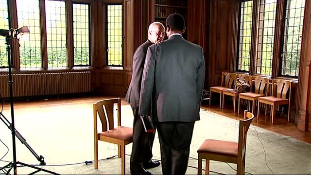 archbishop of canterbury interview on islamic state england london lambeth palace int most rev justin welby shaking hands with reporter and sitting... - カンタベリー大主教点の映像素材/bロール