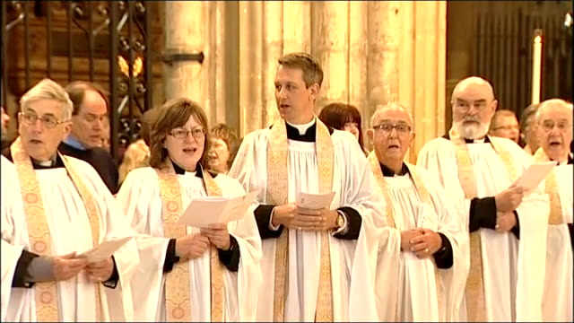 archbishop of canterbury last easter service; england: kent: canterbury: int gvs interiors of cathedral / congregation sing hymn as choir, clergy... - choir stock videos & royalty-free footage