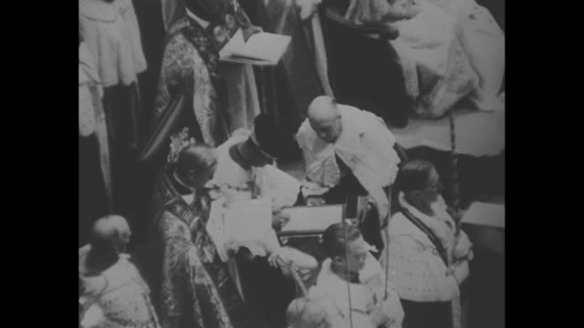 archbishop of canterbury stands behind king edward's chair and bows / king facing aisle bows / king signs declaration archbishop standing beside him... - queen dowager stock videos & royalty-free footage