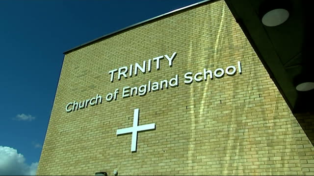archbishop of canterbury visits school to highlight issue of homophobic bullying; ext sign on wall of trinity church of england school - archbishop of canterbury stock videos & royalty-free footage