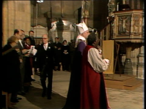 archbishop of cape town desmond tutu processing into canterbury cathedral with archbishop of canterbury robert runcie 09 dec 84 - tutu stock videos & royalty-free footage