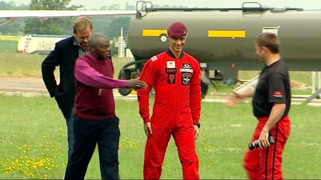 archbishop of york skydiving charity stunt preparations and interview england nottinghamshire raf langar ext general views of archbishop of york dr... - jumpsuit stock videos and b-roll footage