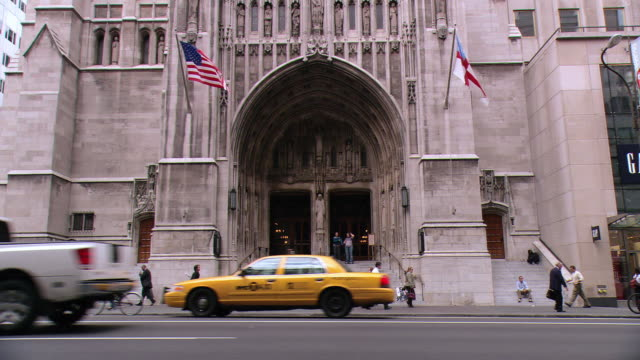 zi arched entrance and doors of st. patrick's cathedral, with pedestrians and traffic / new york city, new york, united states - st. patrick's cathedral manhattan stock videos and b-roll footage