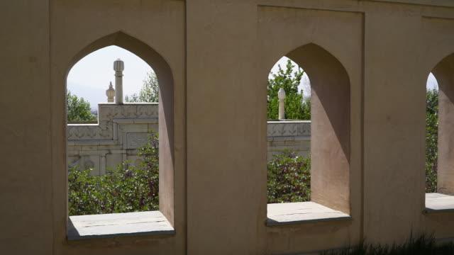 arched windows at tomb of babur in bagh-e babur, kabul, afghanistan. - モスク点の映像素材/bロール