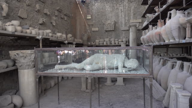 archeological artifacts plaster cast in the ancient ruins sightseeing historic landmark of pompeii, italy, europe. - goodsportvideo stock videos and b-roll footage