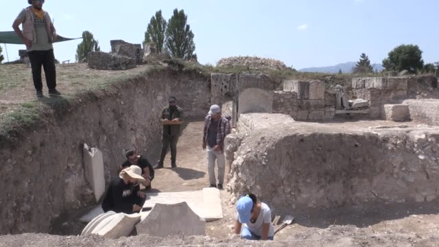 archeologists have unearthed remains of a bathhouse in the ancient city of aizanoi in western turkey talking to anadolu agency zerrin erdinc deputy... - ancient stock videos & royalty-free footage