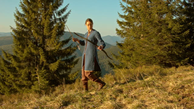 archer in costume to hunt in a mountain forest - archery bow stock videos and b-roll footage