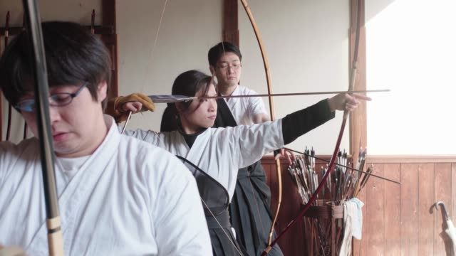 archers practicing the art of japanese kyudo in their dojo - martial arts stock videos & royalty-free footage