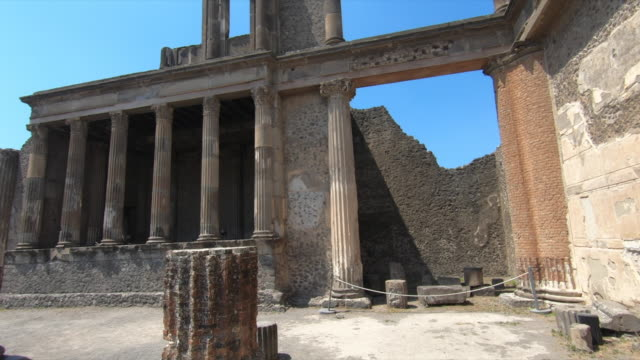 arches and columns in the ancient ruins sightseeing historic landmark of pompeii, italy, europe. - goodsportvideo stock videos and b-roll footage