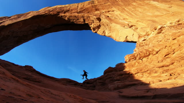 Arches National Park, Moab, Utah, woman running