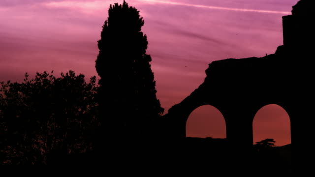 arches of constantine's basilica at dusk - pink colour video stock e b–roll