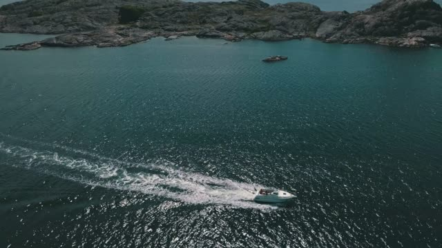 archipelago aerial over water - barca a motore video stock e b–roll