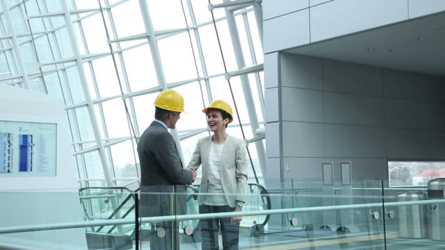 Architect and contractor consultant on building site