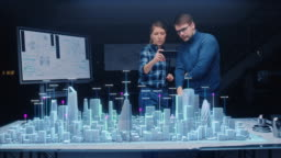 Architect and Engineer have Discussion, Use Augmented Reality Smartphone to Design Sustainable 3D Megalopolis City Model. Futuristic Office with Architectural Designers. Graphical Animation VFX