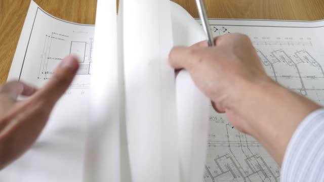 Architect checking house blueprint