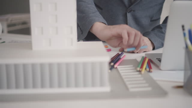 4K: Architect coloring book in his office.