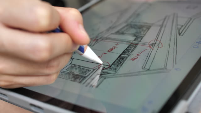 architect comment the details of house plan on digital tablet - architect stock videos & royalty-free footage