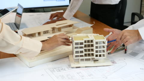 architect defining the design details on architectural model - pen stock videos & royalty-free footage
