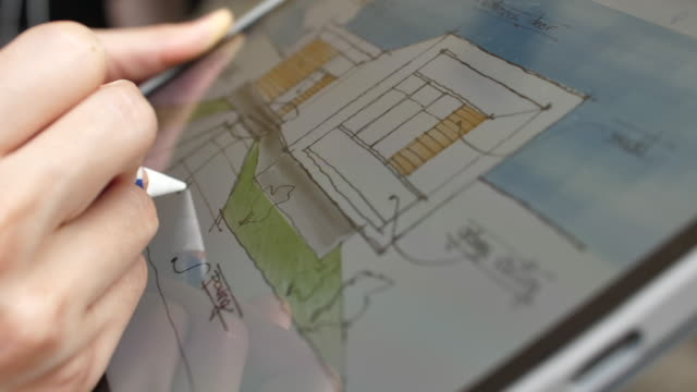 architect design using augmented reality on digital tablet to plan - architetto video stock e b–roll