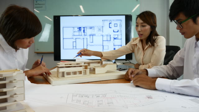 architect discussing with customer on architectural model - architect model stock videos and b-roll footage