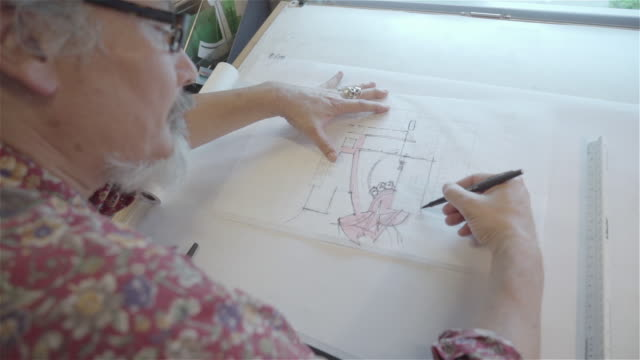 architect drawing a building at a drafting table. - only mature men stock videos & royalty-free footage