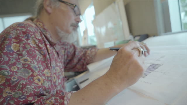 architect drawing at a drafting table. - only mature men stock videos & royalty-free footage