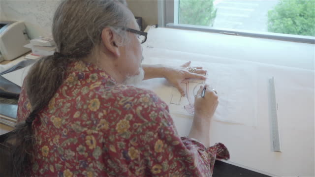 architect drawing on office drafting table. - only mature men stock videos & royalty-free footage