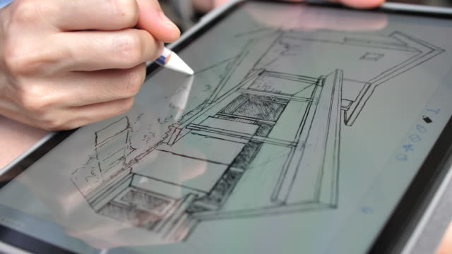 architect drawing sketch home on digital tablet - architetto video stock e b–roll