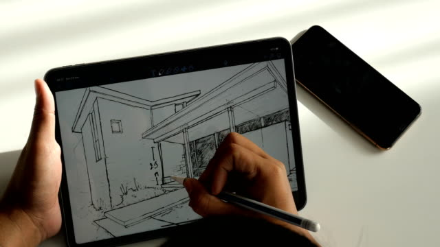 vídeos y material grabado en eventos de stock de arquitecto dibujo sketch home en la tableta digital - instrumento de escribir con tinta
