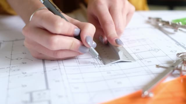 architect hands drawing on blueprint - pair of compasses stock videos & royalty-free footage