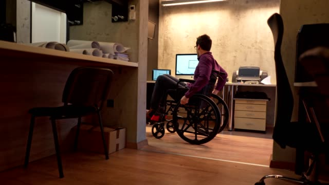 architect in a wheelchair starting his work day - white collar worker stock videos & royalty-free footage