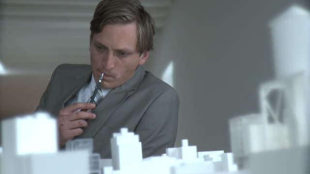 CU R/F Architect looking at architectural model, New York City, New York, USA