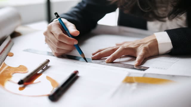architect man holding pencil working on blueprint - pair of compasses stock videos & royalty-free footage