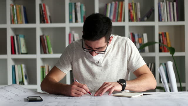 architect man holding pencil working with laptop and blueprints for architectural plan, engineer sketching a construction project concept. - pencil isolated stock videos & royalty-free footage