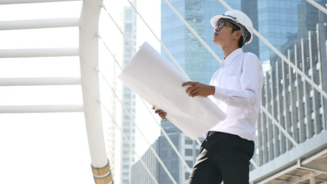 Architect man working outdoor