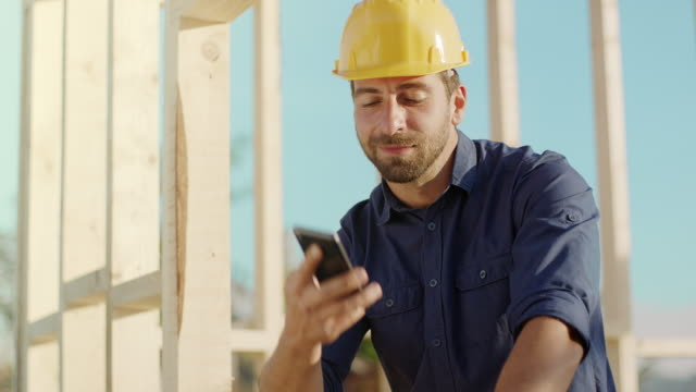 architect talking on the phone at construction site - foreman stock videos & royalty-free footage