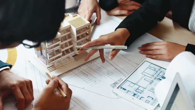 architect team working on architect model together - architecture stock videos & royalty-free footage