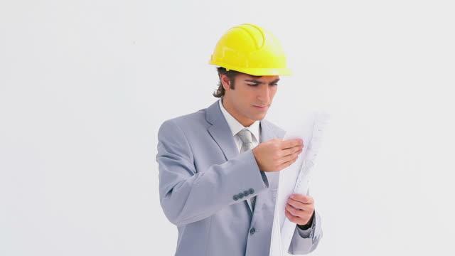 Architect wearing a yellow helmet
