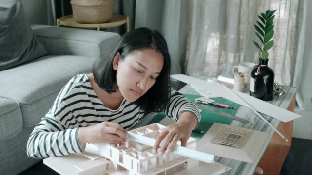architect woman using scale for making her model home - architectural model stock videos & royalty-free footage