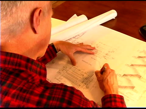 architect working on blueprint - one mature man only stock videos & royalty-free footage