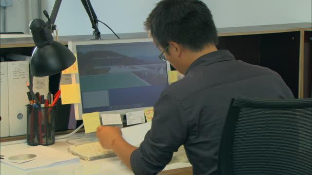 cu, architect working on computer, rear view - デザイナー点の映像素材/bロール