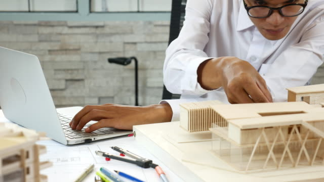 Architect working with his architectural model