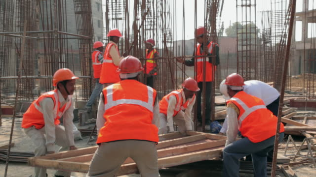 architect working with his team in the construction site, delhi, india - construction site stock videos and b-roll footage