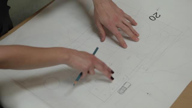 cu architect's hands gesturing over building plans / portland, oregon, usa - architetto video stock e b–roll