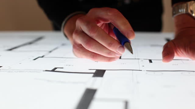 cu pan architect's hands working on blueprint / brussels, brabant, belgium - architetto video stock e b–roll