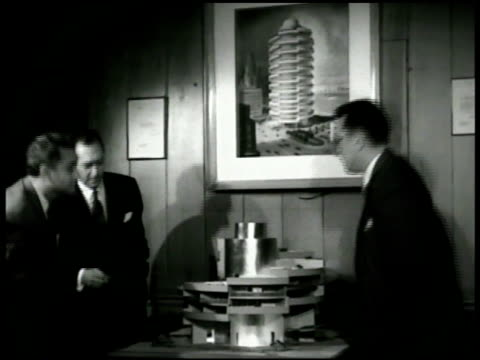 Architects in office looking at building model Modern circular office building print in frame TD MS Circular model could be design for apartment...